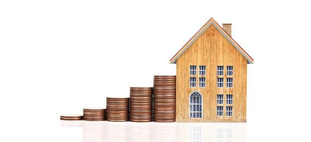 Piani di risparmio del modello di casa con pila di monete per concetto di alloggio, casa e immobiliare