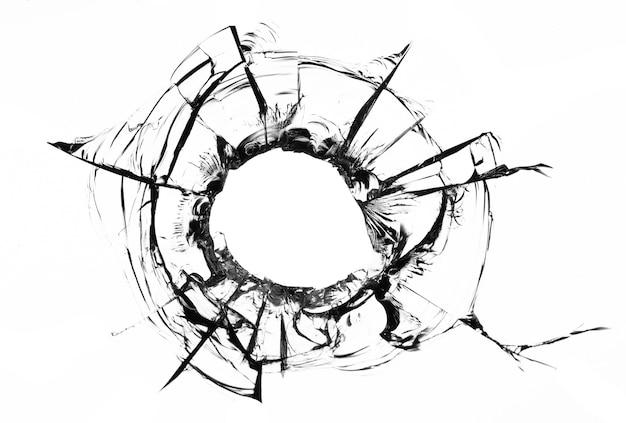 Collage di crepe nel vetro, un foro da proiettili nel vetro su sfondo bianco. struttura del vetro della finestra.