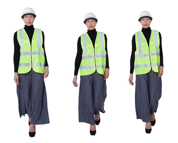 Collage a figura intera che cammina di 40 anni '50 asiatiche lgbtqia+ donna ingegnere indossa un elmetto di sicurezza. la femmina cammina e controlla il cantiere sopra fondo bianco isolato