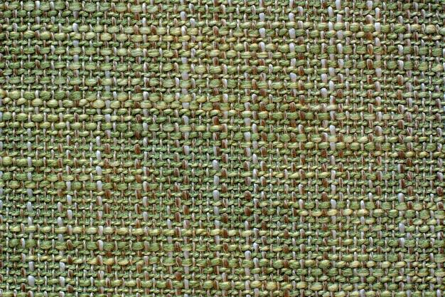 Trama del tessuto di colore. tessuto stropicciato morbido di lana di una tonalità verde.