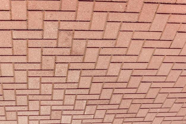 Immagine a colori della pavimentazione piastrellata in mattoni rossi, dettaglio dello sfondo