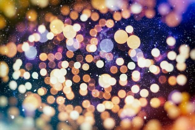 Il disegno del layout di sfondo glitter chiaro sfocato astratto colorato può essere utilizzato per il concetto di sfondo o lo sfondo del festival.