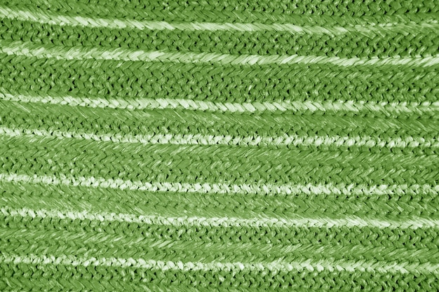 Sfondo texture paglia naturale colorata. borsa in vimini paglia intrecciata. modello di canapa da una borsa. tessuto dettaglio modello, struttura del grunge. primo piano ruvido del fondo della paglia di vimini