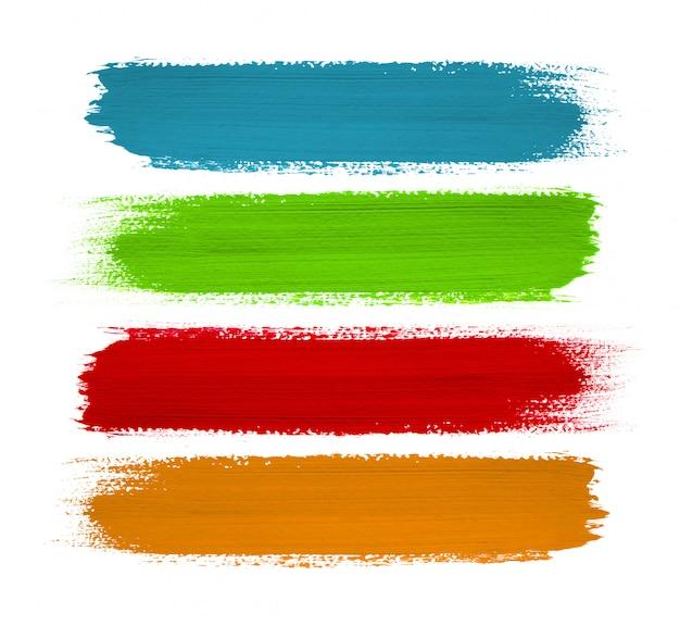Colpi di vernice colorata su bianco