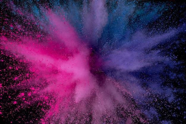 Esplosione di polvere colorata. polvere astratta del primo piano sul contesto. esplosione colorata. dipingi holi