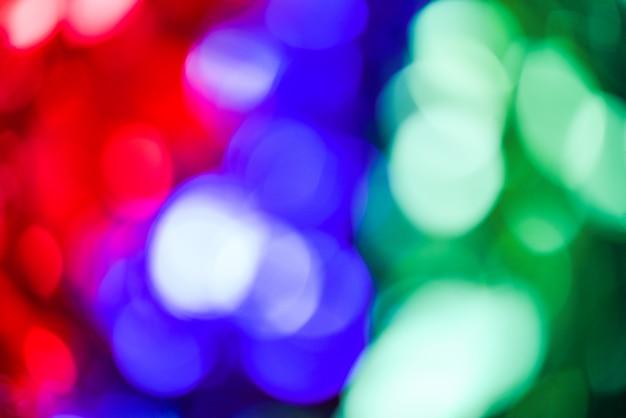 Fondo variopinto del bokeh con rosso verde blu e l'estratto del bokeh dalle luci