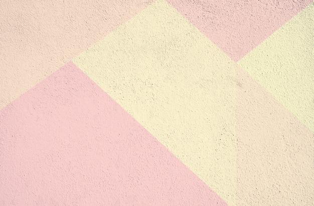 Struttura del fondo dipinta calcestruzzo variopinto. giallo rosa