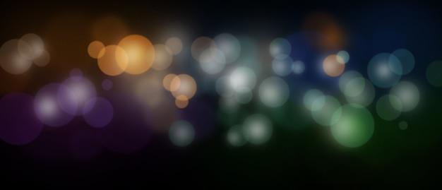 Luci bokeh sfocate colorate in sfocatura dello sfondo notturno