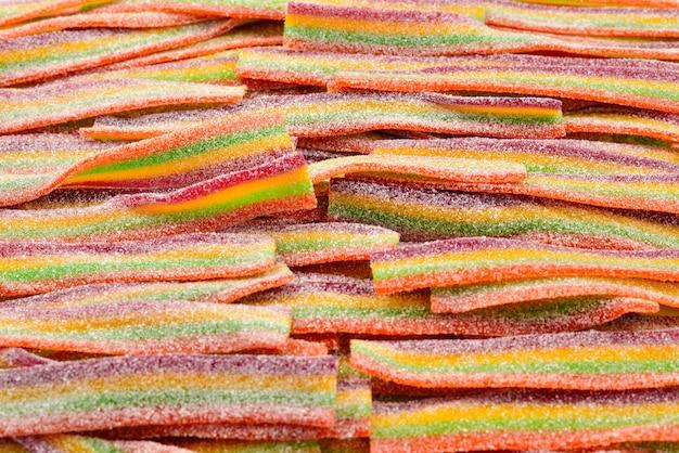 Sfondo colorato jelly bean. modello di caramelle di gelatina.