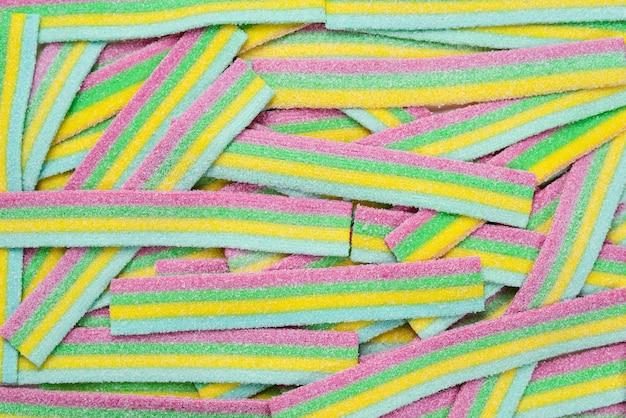 Sfondo di caramelle gommose succose colorate. vista dall'alto. dolci di gelatina.