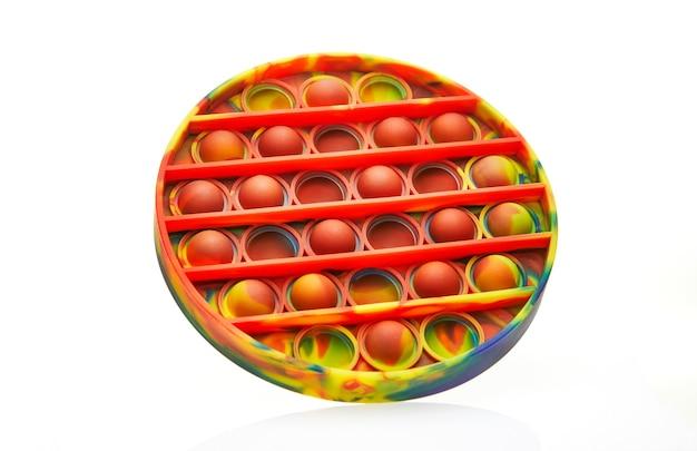 Giocattolo antistress sensoriale a bolle colorate push pop, isolato.