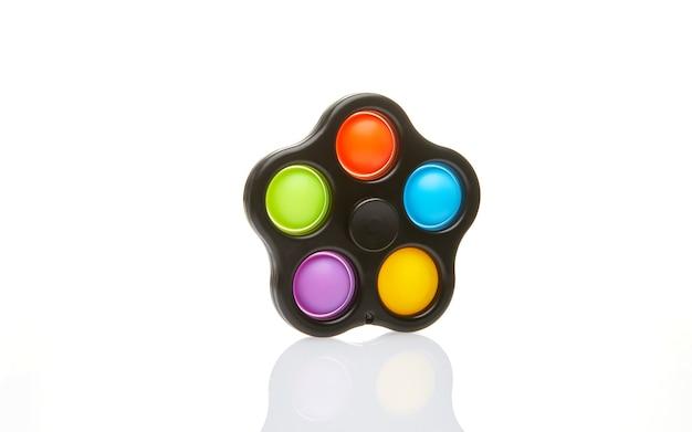Spinner colorato e giocattolo antistress sensoriale a bolle pop push, isolato.