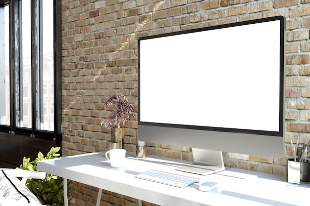 Computer sul desktop con rendering 3d dello schermo bianco
