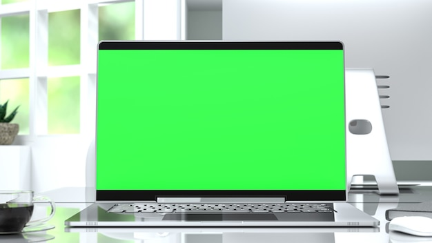 Computer mock up con schermo verde sulla scrivania rendering 3d