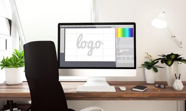 Computer con software per la creazione di logo sul tavolo. rendering 3d