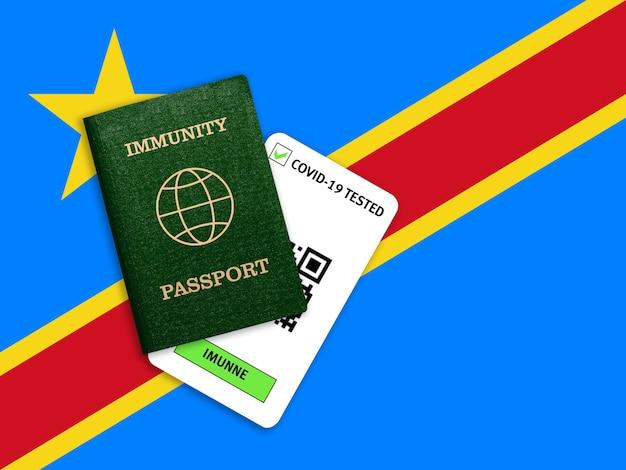 Concetto di immunità al coronavirus. passaporto di immunità e risultato del test per covid-19 sulla bandiera del congo