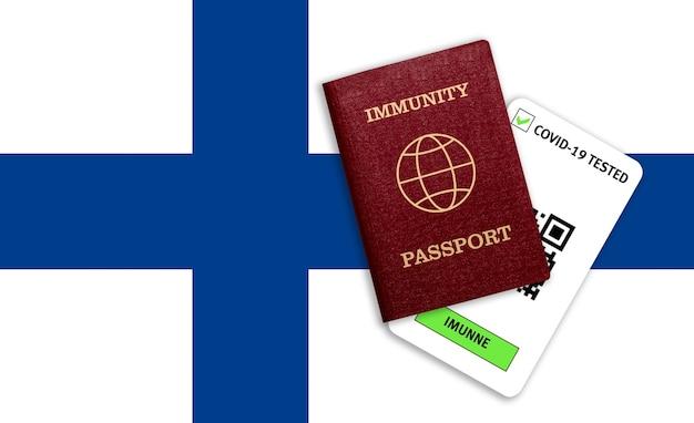 Concetto di immunità al coronavirus. passaporto di immunità e risultato del test per covid-19 sulla bandiera della finlandia.