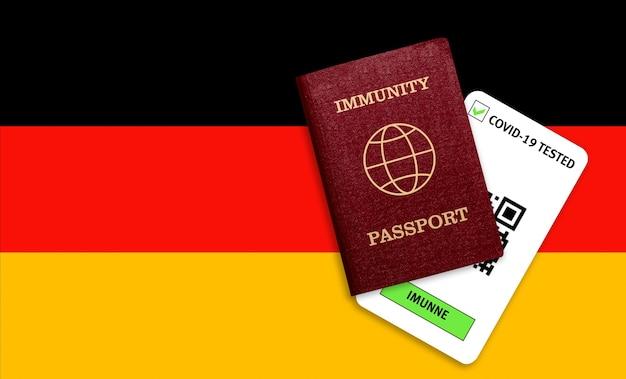 Concetto di immunità al coronavirus. passaporto di immunità e risultato del test per covid-19 sulla bandiera della germania.