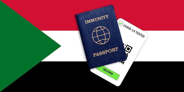 Concetto di immunità al coronavirus. passaporto di immunità e risultato del test per covid-19 sulla bandiera del sudan.