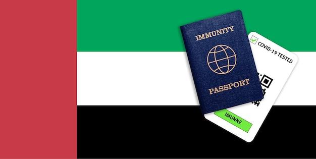 Concetto di immunità al coronavirus. passaporto di immunità e risultato del test per covid-19 sulla bandiera degli emirati arabi uniti.