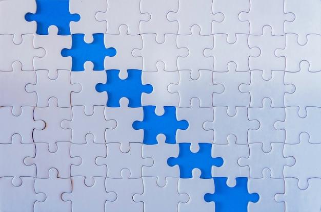 Concetto di lavoro di squadra con jigsaw
