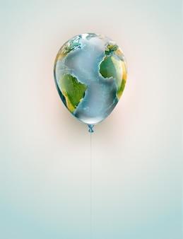 Immagine concettuale di un palloncino con una mappa del mondo su uno sfondo chiaro
