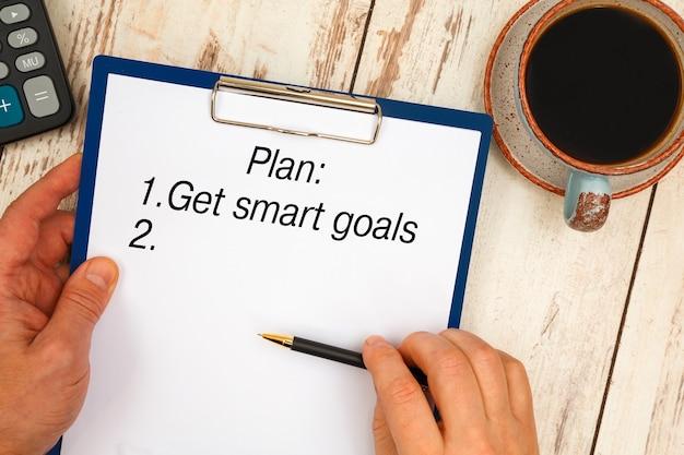 Manoscritto concettuale che mostra ottenere obiettivi intelligenti.