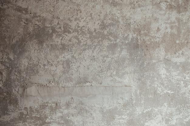 Vecchia annata grigia concreta di struttura del fondo della parete