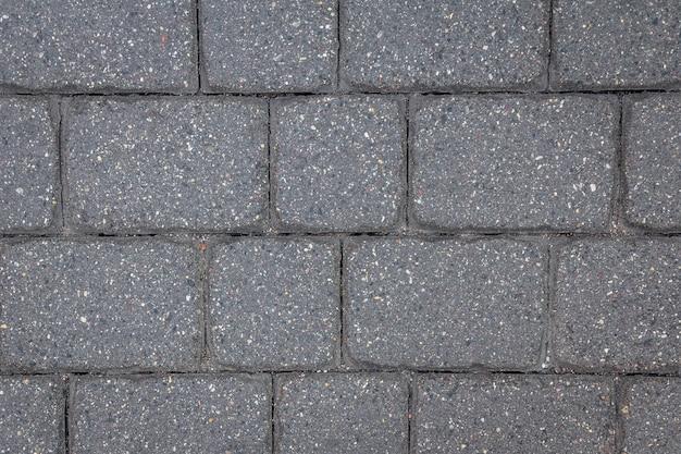 Struttura delle mattonelle di cemento. priorità bassa della pavimentazione della città.