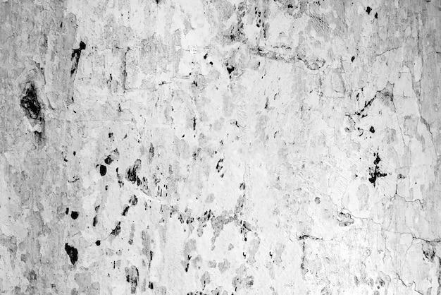 Sfondo texture muro di cemento. frammento di muro con graffi e crepe