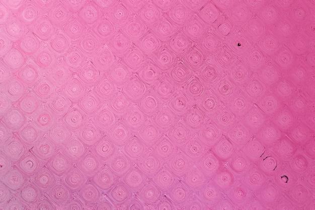 Struttura del muro di cemento verniciato in colore rosa. sfondo astratto