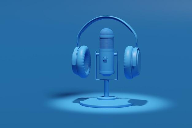 Microfono a condensatore, cuffie isolate su uno sfondo blu.