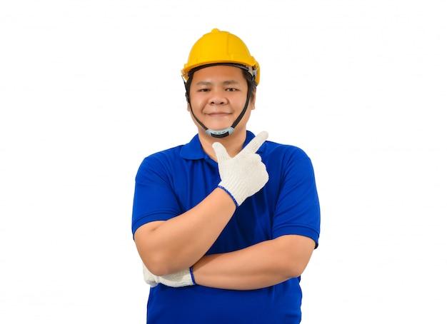 Lavoratori dell'uomo della costruzione in camicia blu con i guanti protettivi