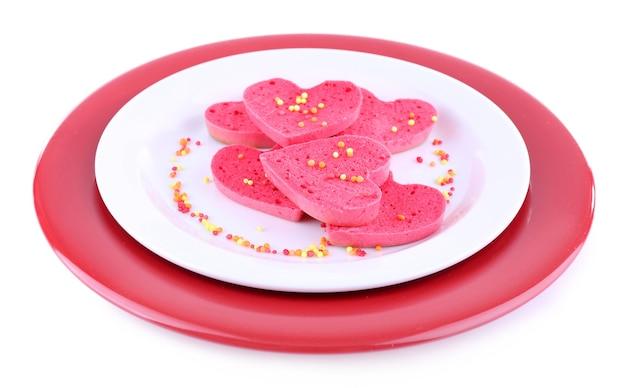 Biscotti a forma di cuore isolato su bianco