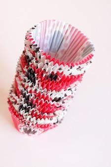 Accessori per la cottura della cottura stampi di carta per cuocere i muffin su un rosa