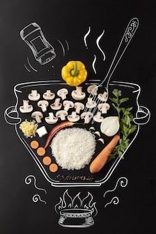 Pentola sul fuoco insieme di ingredienti per crema di funghi zuppa di funghi riso cipolla carota e