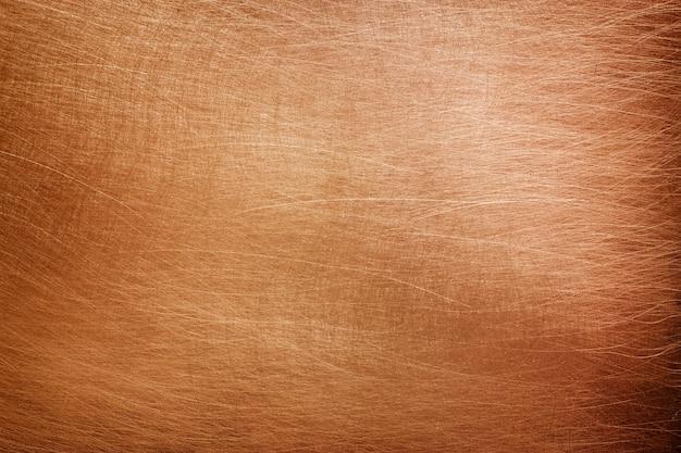 Struttura in lastra di rame, superficie metallica arancione spazzolata