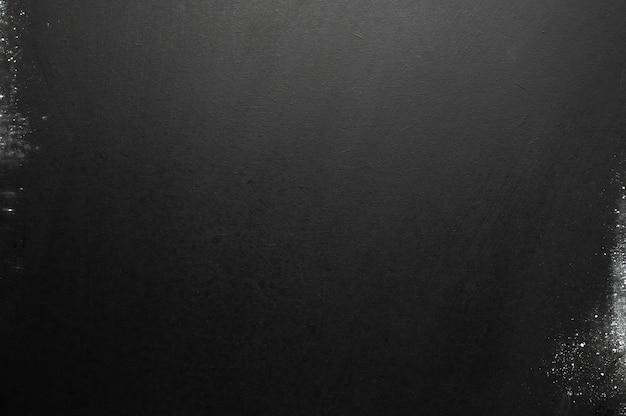 Copia spazio lavagna nera con sfondo texture macchia di gesso