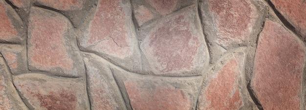 Corallo vecchio muro di pietra sfondo panoramico. sfondo per il design dell'ufficio