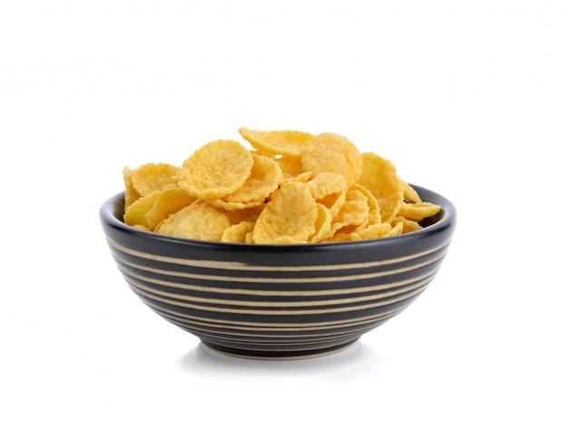 Cereale dei fiocchi di granturco sulla ciotola isolata