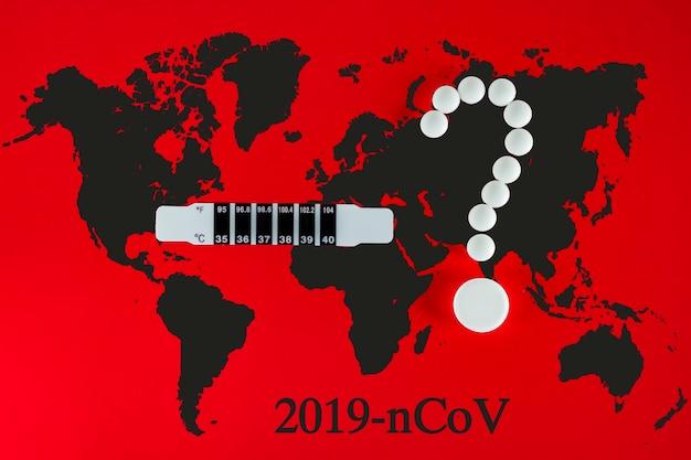 Coronavirus 2019-ncov nuovo concetto di coronavirus responsabile dell'epidemia di influenza asiatica come pandemia di casi di ceppi influenzali pericolosi. pillole bianche nel punto interrogativo della forma, termometro, terra su rosso.