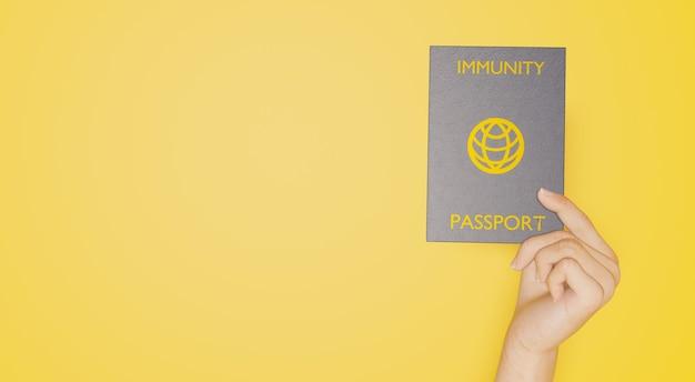 Passaporto di immunità al coronavirus tenuto in mano rendering 3d