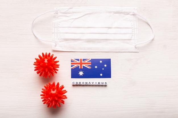 Coronavirus ncov concept vista dall'alto maschera protettiva respiratoria e bandiera dell'australia