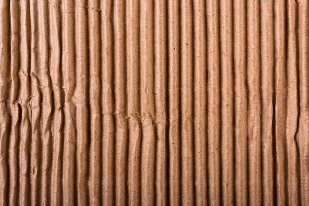 Foglio di cartone marrone ondulato di texture di carta