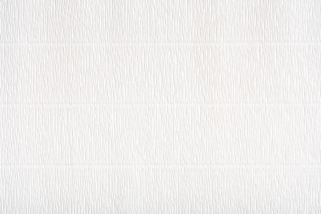 Texture di carta ondulata. trama di carta d'arte bianca. trama di carta grigio chiaro con superficie ondulata. sfondo astratto