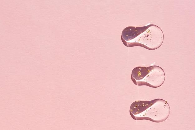 Struttura del colpo dello striscio del siero del gel cosmetico. minimalismo di lusso. luce solare, prodotto per la cura della pelle ancora in vita con copia spazio
