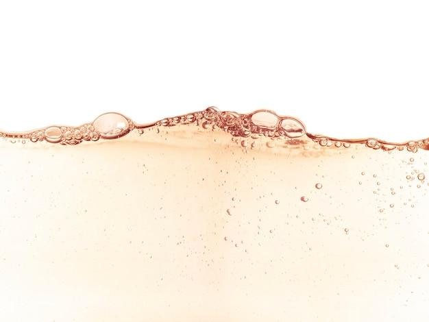 Crema idratante cosmetica pelle tonica acqua, toner o emulsione arancione texture astratta sfondo