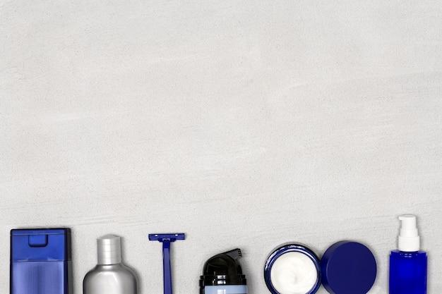 Cosmetici per uomo. prodotti per la rasatura e la cura della pelle per uomo su fondo concreto. copia spazio