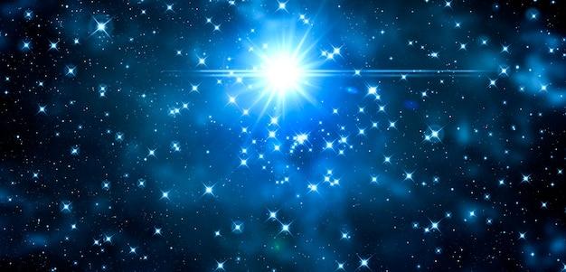Sfondo cosmico con lo splendore delle stelle e lo splendore di una stella blu su fondo nero