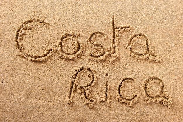 Messaggio scritto a mano della sabbia della spiaggia della costa rica